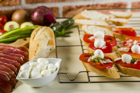 bruschetta with tomatoes, mozzarella, Parma ham and basil - seasoned with oregano