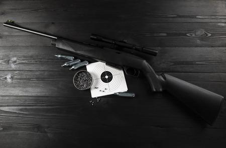 air rifle on co2 and ammunition on the shooting range 版權商用圖片