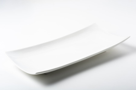 a white rectangular plate with rounded corners Stock Photo