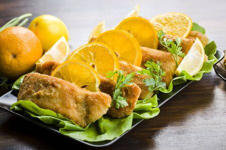 Carp - Christmas fish in Polish cuisine - served in oranges
