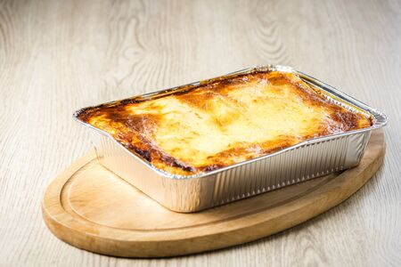 a portion of lasagna with deliciously browned cheese straight from the oven