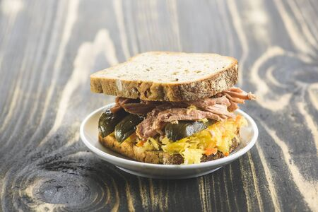 sandwich with pulled pork and sauerkraut - variants with different breads