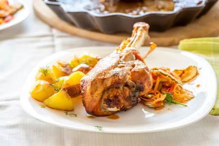 baked turkey leg with potatoes and vegetable salad