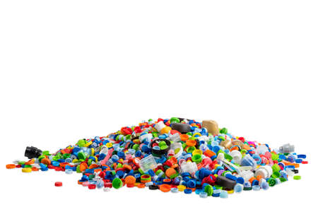 spilled plastic caps on white background