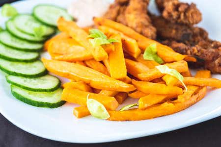 Sweet potato fries and chicken tenderloin Stok Fotoğraf
