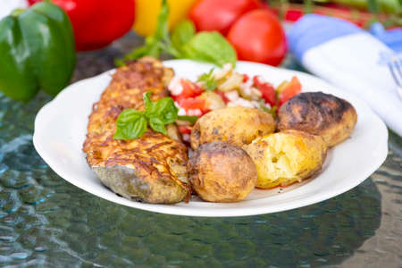 baked zucchini served with baked potatoes