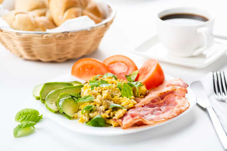 bacon and eggs with avocado and tomato