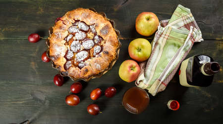 homemade apple and plum cake on wooden table