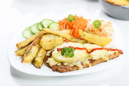 Hawaiian cutlet with baked potatoes and a bouquet of salads