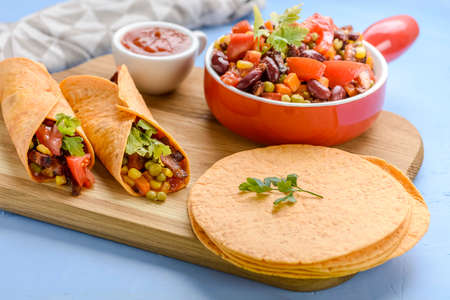 Preparation of tacos - delicious ingredients include tortilla and meat and vegetable stuffing Stock fotó