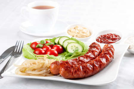 Hearty breakfast - fried sausage with toppings Stock fotó