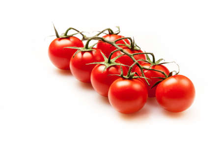some tomatoes on a white background