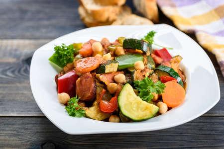 Spanish cauldron - stew with chickpeas, zucchini and chorizo sausage