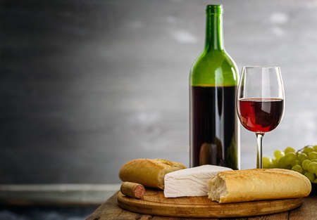 A small snack - baguette, cheese and wine in the atmospheric interior of an old winery