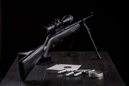 air rifle carabiner on wooden table
