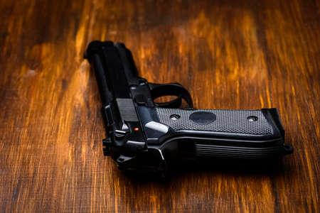 handgun on a wooden table Stock fotó
