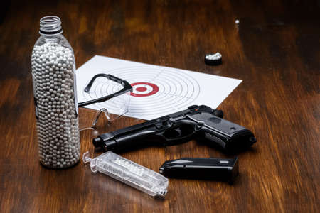 pistol replica, shield, glasses, speedloader and plastic balls - preparation for the game - side weapon