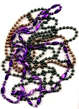 Mardi Gras beads tradional colors of green, purple and gold isolated on white background.