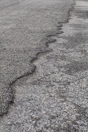Edge of ashphalt county road is worn away, needs repair