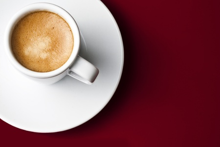 Coffee cup on red background