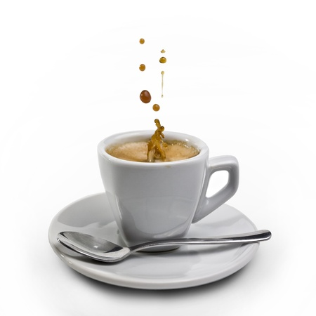 espresso machine: Splashing coffee on isolated coffee cup