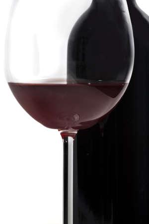 Wine glass and bottle Standard-Bild