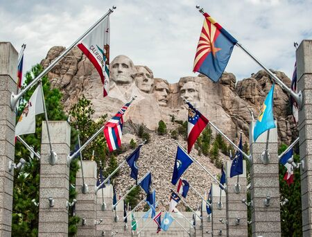Mount Rushmore with country flags
