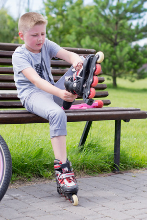 little boy puts his feet on the rollers photo