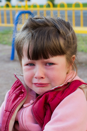 dolorous: little girl crying in the playground