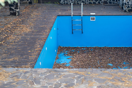empty surface: autumn fallen leaves in an empty swimming pool
