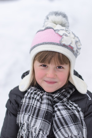 portrait of a little girl outdoors in winter photo