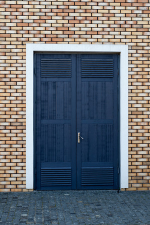 input wooden door in an old brick wall photo