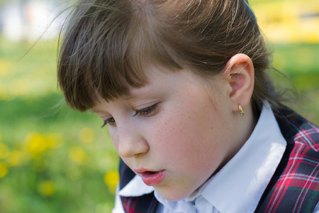 sundress: little girl close-up in white blouse and school sundress Stock Photo