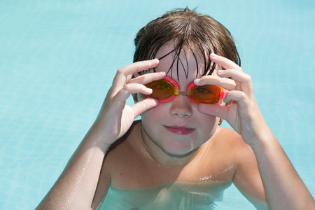 little girl wears glasses at the pool for swimming Stock Photo