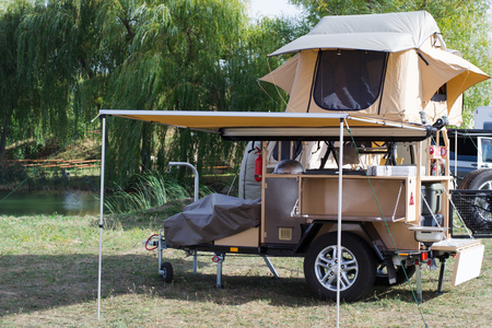 amenities: Car tourist tent with all the amenities installed on a trailer for motorcars