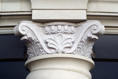 architectural lighting design: fragment of the carved supporting columns propping beam ceiling