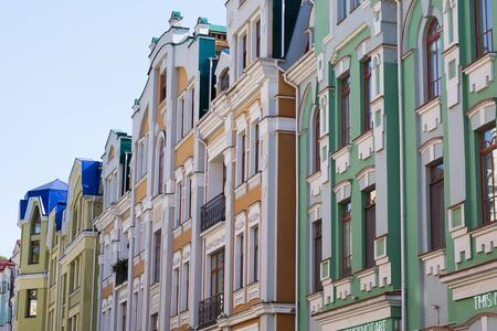 storied: antique European small street with a few colorful storied buildings with beautiful architecture