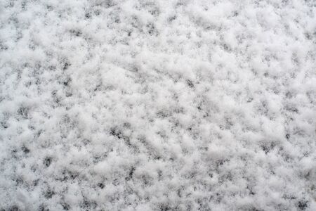 space for writing: white snow on the ground close-up for background with space for writing Stock Photo