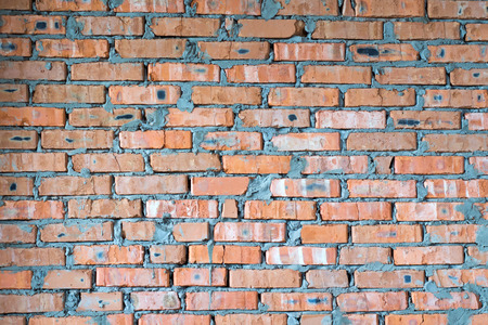 casually: casually laid a brick wall from an ordinary red brick Stock Photo