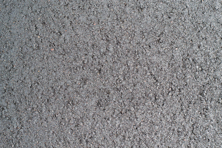 compacted: new black freshly made compacted asphalt closeup