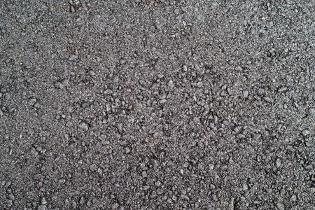 coarse black freshly made compacted asphalt closeup Stock Photo