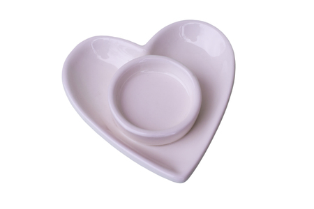 candlestick saucer in the shape of heart isolated on white background top view of a  close-up
