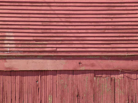 faded: red worn and weathered siding on side of old train depot Stock Photo