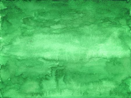 green abstract watercolor background on white paper