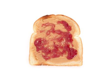 peanut butter and jelly on toasted white bread photo