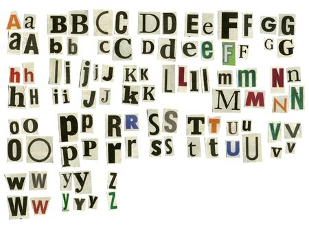 cut paper letters of various fonts on white surface Stock Photo