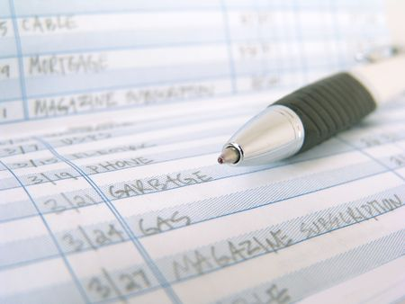check book register with pen with entries