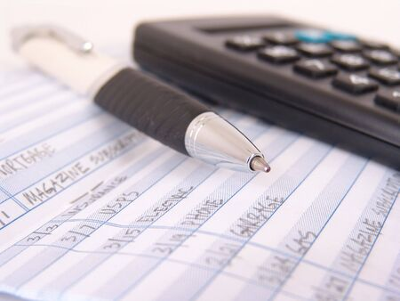 check book register with pen and calculator