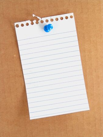 paper pin: piece of white note paper tacked to surface with blue push pin