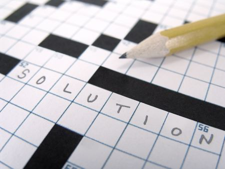 crossword puzzle and pencil, with the word solution filled in for answer